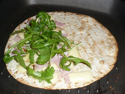 Add rucola to the tortilla sandwich
