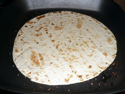 Heat the tortilla on the stovetop grill